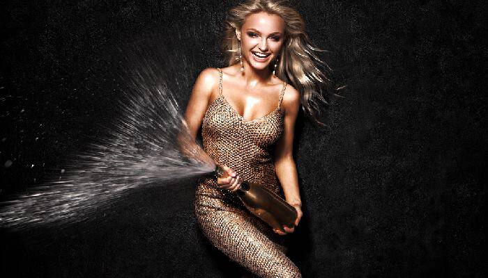 picture of a woman spraying champagne
