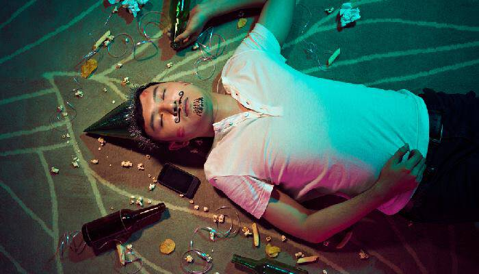 picture of drunk man lying on the floor
